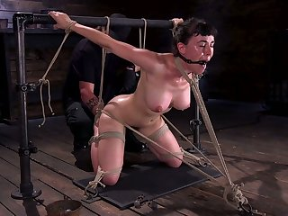 Kinky dude punishes Olive Glass's hairy pussy up vibrator in the dark basement