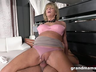 Mature non-professional with large boobs having sexual relations with a younger suppliant