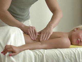 Nude blonde enjoys more than just massage